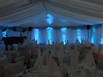 Blue venue lighting in wedding Marquee,