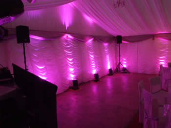 pink venue lighting in wedding Marquee,