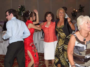 Marriott Hotel Worsley, bride dancing with her mother and mother in-law