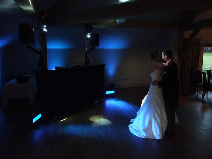 Wedding 1st dance, with the venue lighting acting as a great backdrop