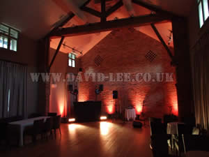 Orange Venue lighting in Arley hall wedding venue