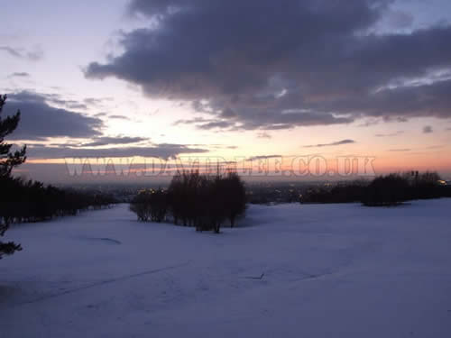 views across manchester in the snow from Dukinfield Golf Club