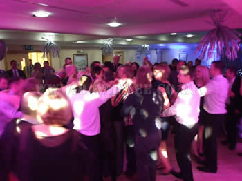 Dukinfield Golf Club wedding party dancing with pink venue lighting