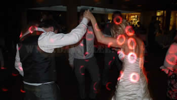 Bride and groom dancing at white hart