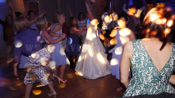 Bride and guests hand in th eair at Arley Hall